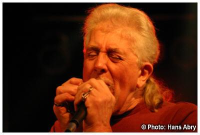 John Mayall plays harmonica live
